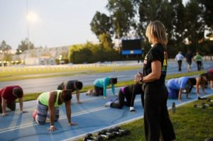 Participants in a Bruin Health Improvement Program class workout at Drake Stadium. Credit: UCLA Recreation